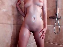 Teen having a bathroom and shaving in a solo video
