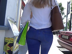 Candid blonde nubile in flesh tight denim