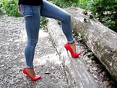 Extraordinary high-heeled shoes and jeans, my sexy legs,walk in the forest