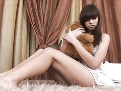 Beautiful russian teen strips on her sofa