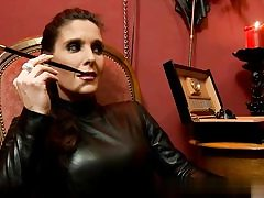 Nasty cockslut dressed in all leather on fuck tape smoking a cigarette